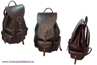 VERY LARGE LEATHER BACKPACK WITH 4 POCKETS MADE IN SPAIN OF ARTISANAL SHAPE AND CLOSURE BELTS IN POCKETS